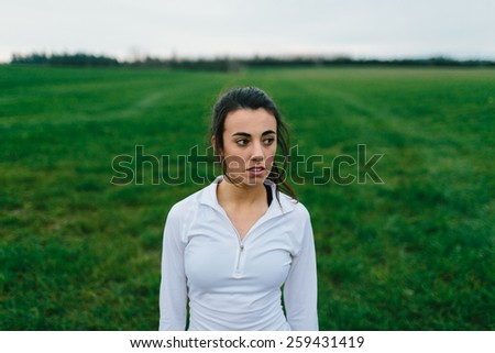 Young Adult Female Standing in Country Field - stock photo