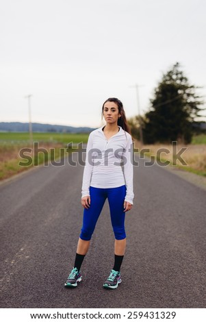 Young Adult Females standing on country road