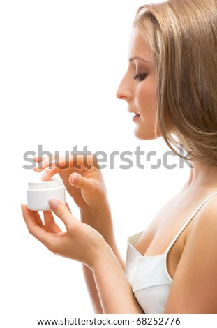 Young adult girl applying moisturiser cream. Healthcare concept. - stock photo