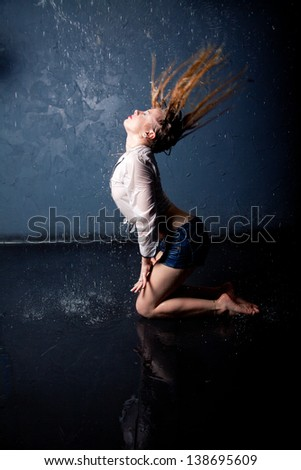 young adult girl dancing in water