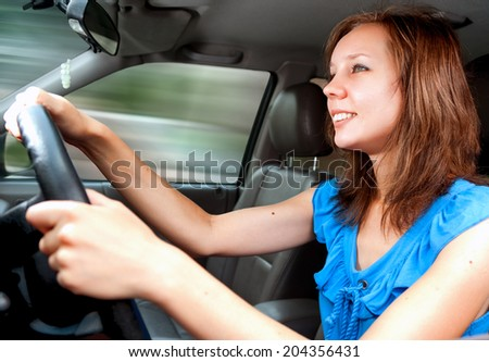 Young adult girl driving a car first time