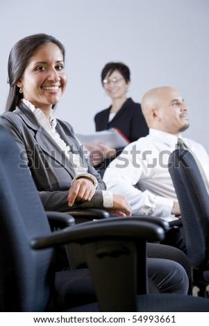 Young adult Hispanic university students or business people watching presentation - stock photo