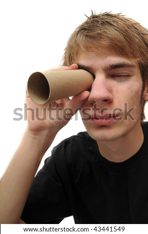 Young adult looking through brown cardboard toilet paper roll tube isolated on white - stock photo