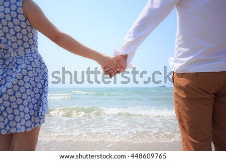Young adult male groom and female couple making romantic heart shape on beach , Love story. - stock photo