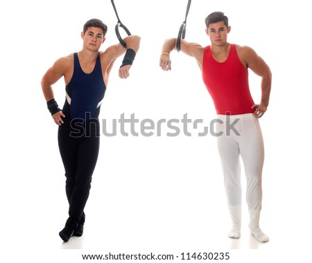 Young adult male gymnasts. Studio shot over white. - stock photo