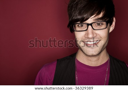 Young adult male smiling - stock photo