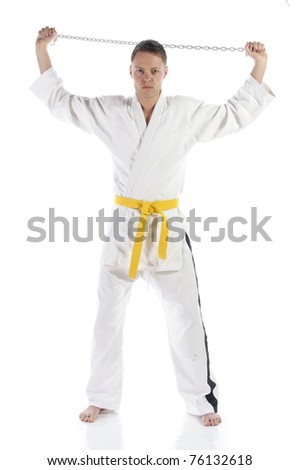 Young adult man doing martial arts, isolated against a white background