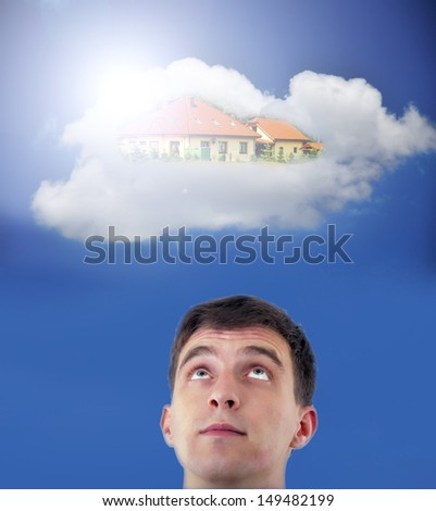 Young adult man dreaming about new house