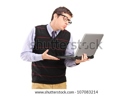 Young adult man giving a kiss and looking at a laptop computer isolated on white background