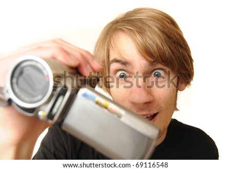 Young adult man holding a camcorder isolated on white background - stock photo