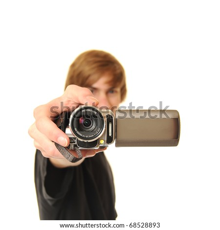 Young adult man holding a camcorder isolated on white background. This image works great for demonstrating the power of Online Video.