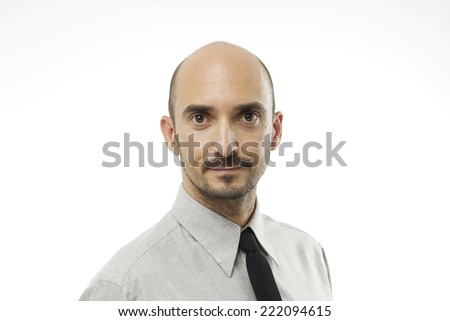 Young adult man looking at camera and smiling. He looks confident and happy. - stock photo