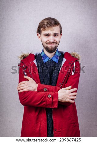 Young adult man looking at camera displeased and angry - stock photo