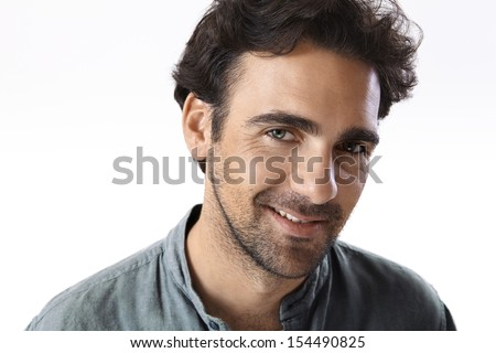Young adult man looking at camera with a seductive look