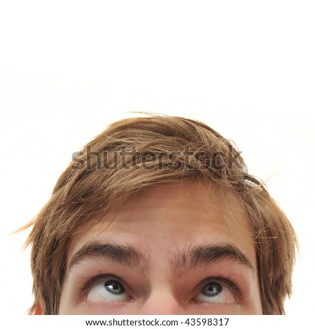 Young adult man staring up with cross eyes into empty white isolated copy space
