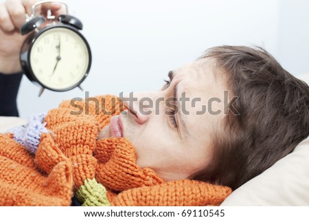 young adult man wake up in the morning and sad - stock photo