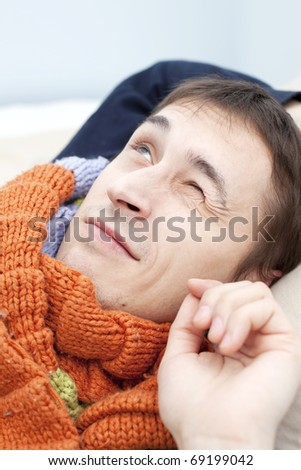 young adult man wake up in the morning and smile. closeup - stock photo