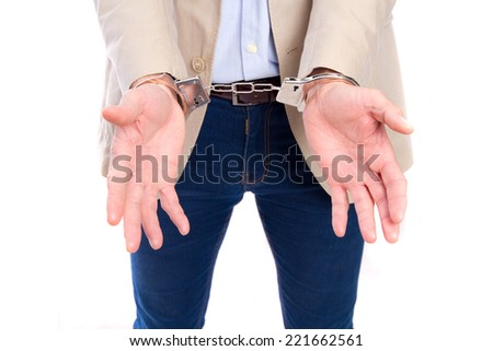 young adult man with a handcuffs