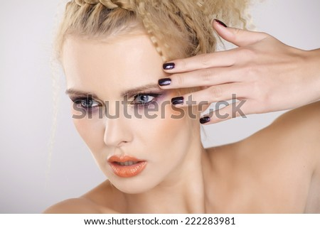 Young adult pretty blonde woman with beautiful hairs and multicolor makeup isolated on white background - stock photo