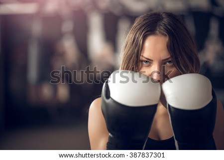 Young adult sexy boxing girl posing with gloves. - stock photo