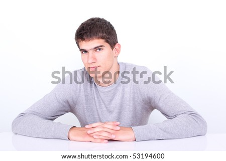 Young adult sitting next to the desk