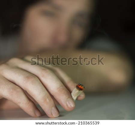 Young adult smoking marijuana - stock photo