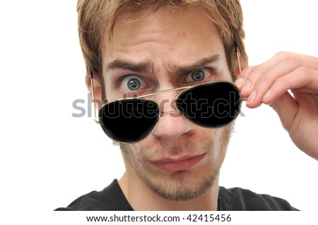 Young Adult Taking Aviator Sunglasses off - stock photo