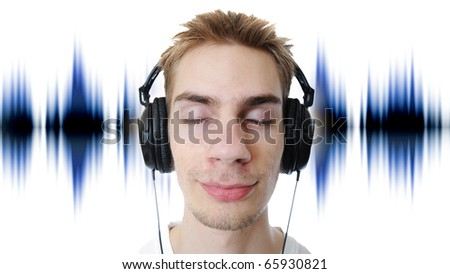 Young adult teen listens to music in his headphones. Isolated on white background.
