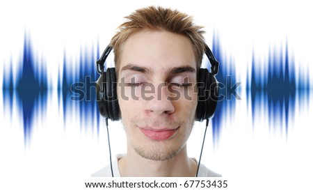 Young adult teen listens to music in his headphones. Isolated on white background. - stock photo
