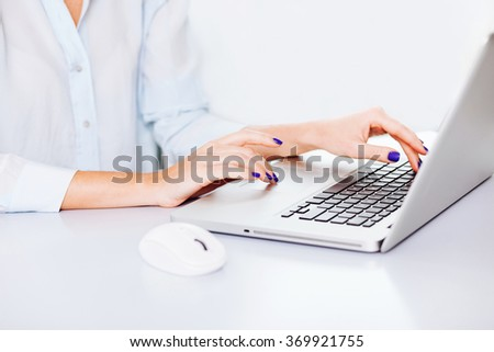 Young adult using laptop