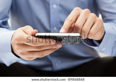 Young adult using mobile smart phone