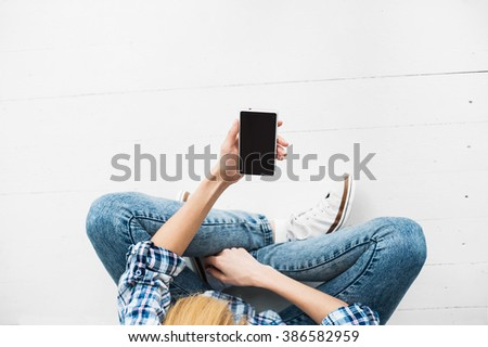 Young adult using smart phone. Technology - stock photo