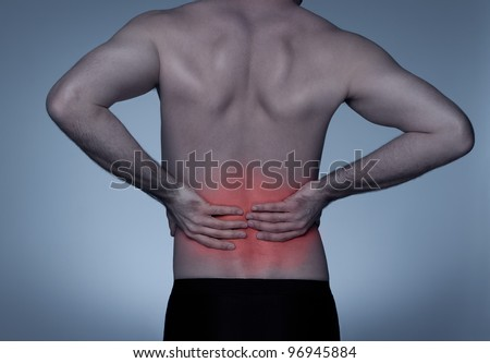 Young adult with back pain - stock photo