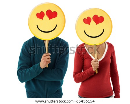 young adult woman and man holding emoticon with red hearts on white background. Horizontal shape, front view, waist up - stock photo