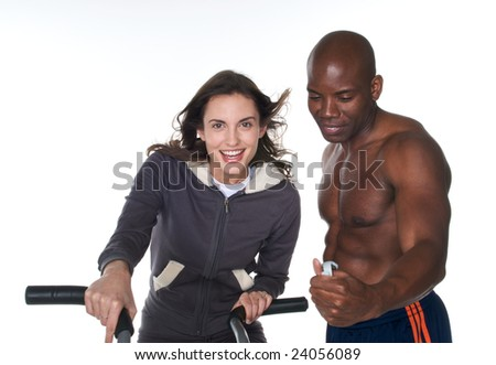 Young adult woman feeling happy as personal trainer chronograph her time with good results. - stock photo