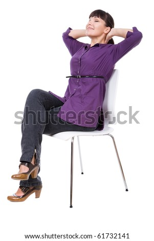 young adult woman sitting on chair. over white background - stock photo