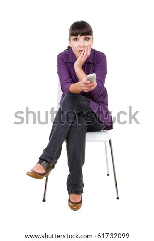 young adult woman watching tv. over white background - stock photo