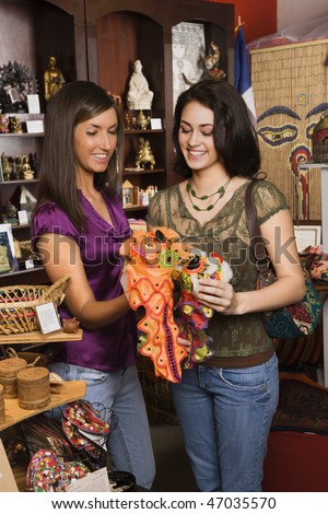 Young adult women shopping in a retail interior design store. Horizontal shot. - stock photo
