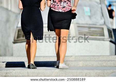 Young adult women walking up the stairs - stock photo