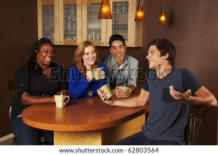 Young Adults hanging out in coffee house - stock photo