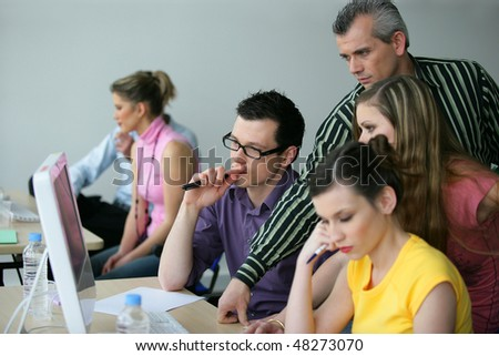 Young adults in business training - stock photo