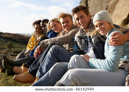 Young adults in countryside - stock photo