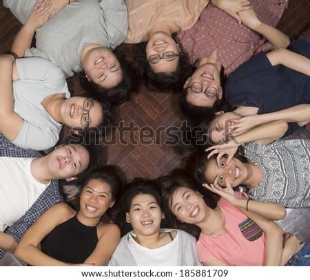 Young adults laying down having fun - stock photo