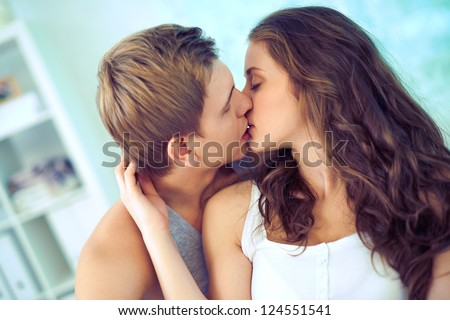 Young affectionate couple kissing tenderly - stock photo