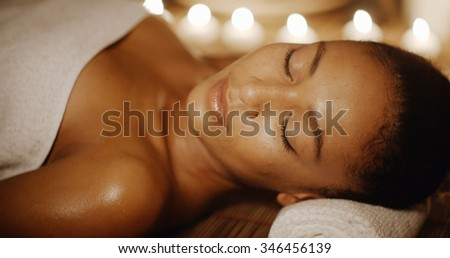 Young african-american beautiful woman relaxing at the spa - stock photo