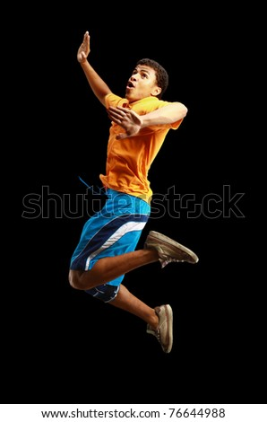 Young african American boy jumping with extended arms - stock photo