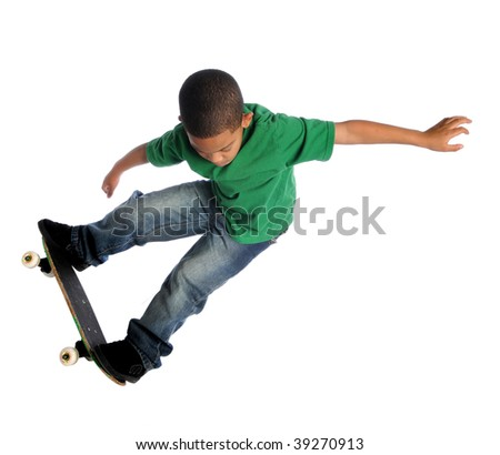 Young African American boy performing trick with skate board isolated over white - stock photo