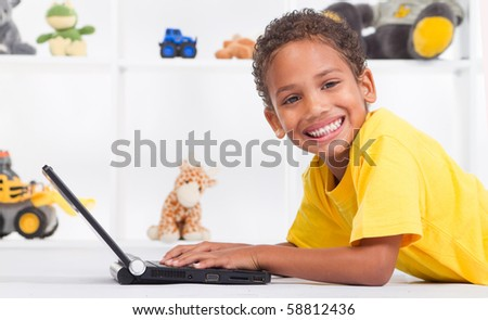 young african american boy playing on laptop computer - stock photo