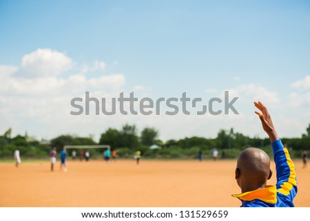 Young african american boys playing european football outdoor - stock photo