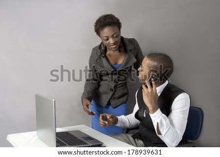 Young African American Business Couple discussing work - stock photo